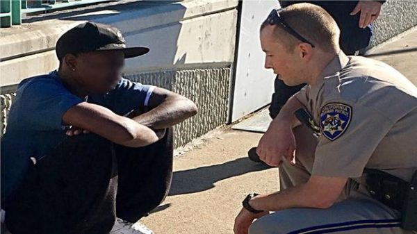 Contra Costa County CHP officer Thomas Westropp-Bennett is pictured with a man he saved from jumping off the Benicia Bridge on Nov. 17, 2016. (CHP/Twitter)