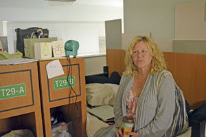 Kandi Ochs sits on her bed in transitional housing at the shelter, where she'll likely stay through the holidays.
